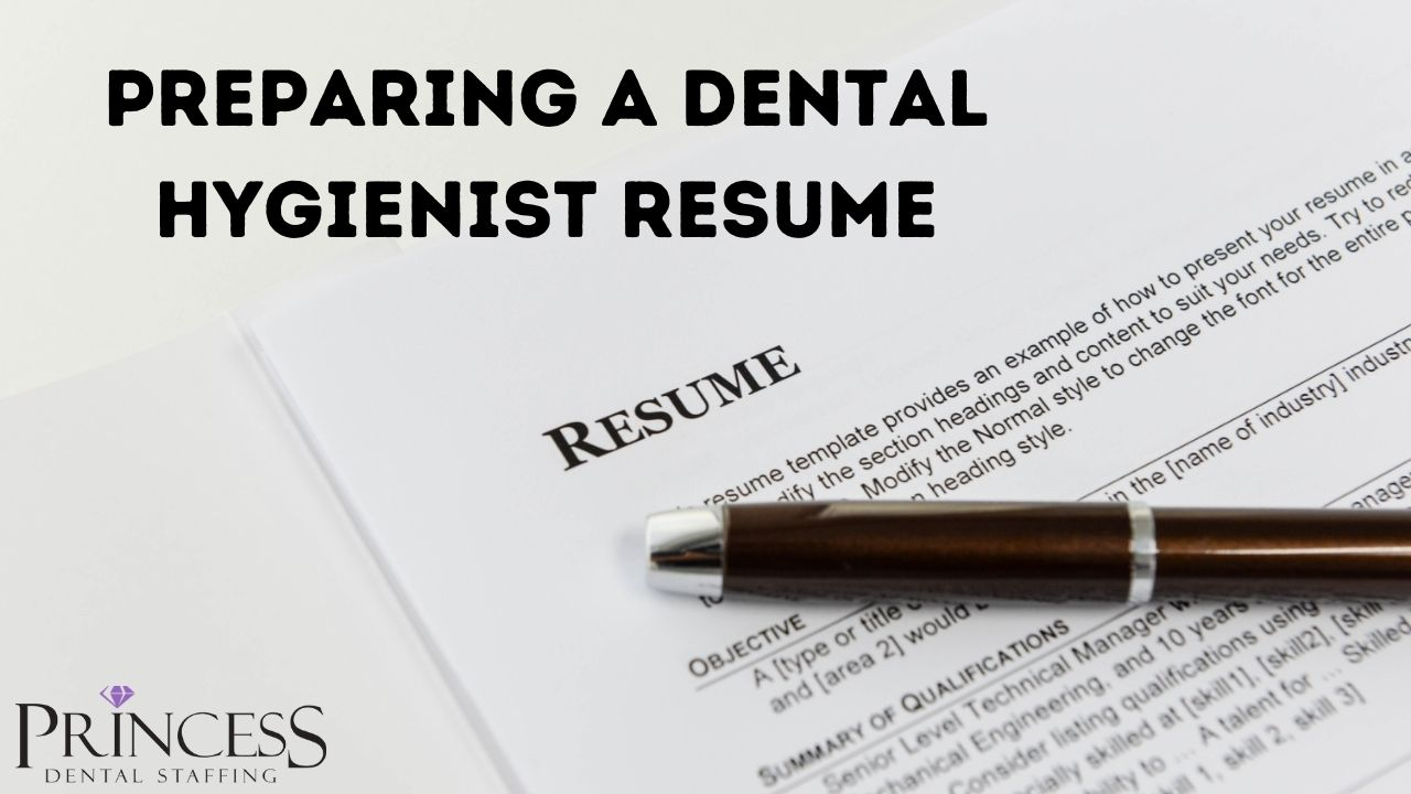 Writing a dental hygienist resume with a pen and paper.