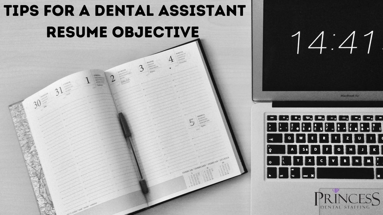 Writing a dental assistant resume objective on a laptop.
